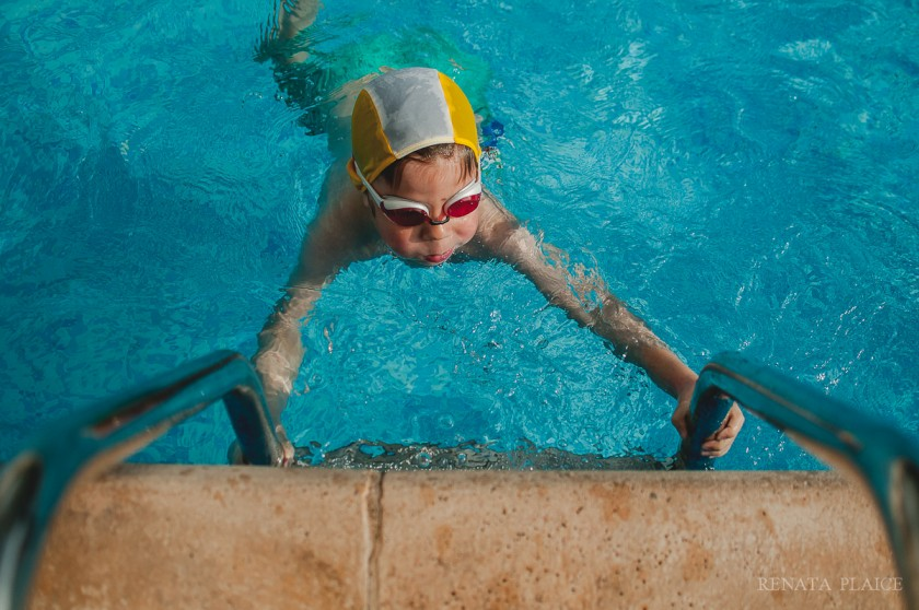 child swimming towards ladder by Renata Plaice