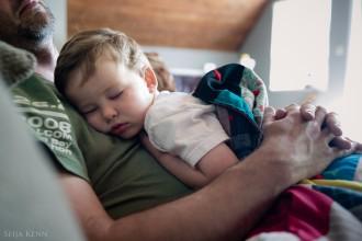 child taking a nap on dad by Seija Kenn