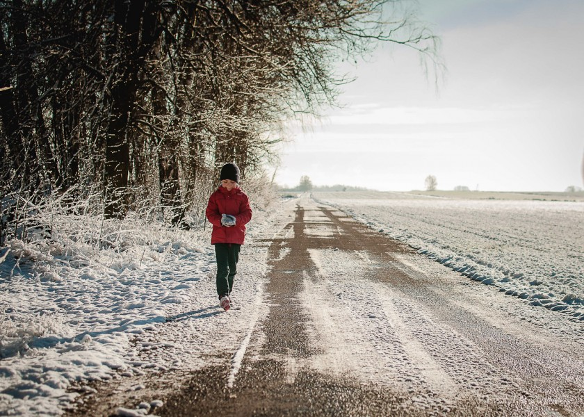 child walking in the snow by Renata Plaice