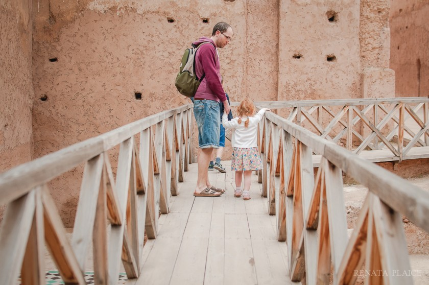 dad and daughter walking on a bridge by Renata Plaice