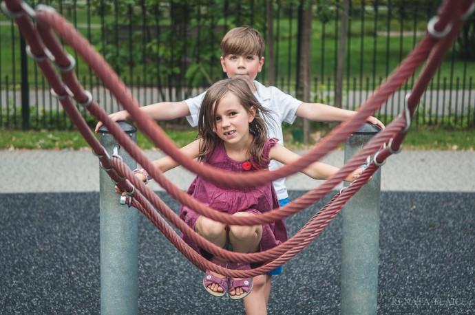 kids playing at a playground by Renata Plaice