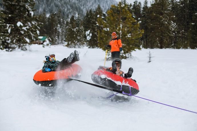 kids snow tubing by Kim Hildebrand