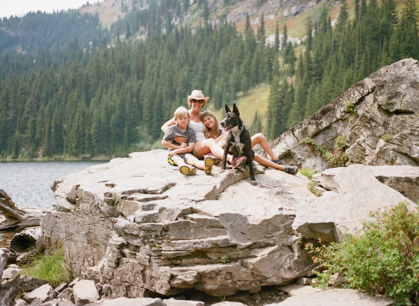 mom and kids on a rock by Kim Hildebrand