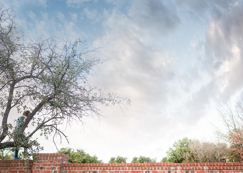 boy walking on a brick