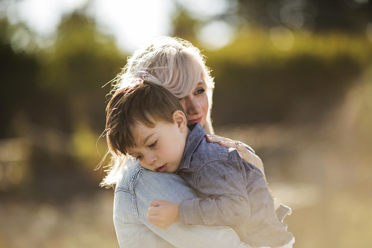 mom holding son by Elena Blair