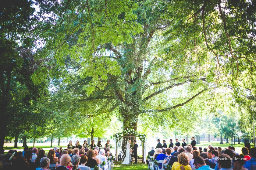 wedding ceremony under a large tree by Lissa Chandler