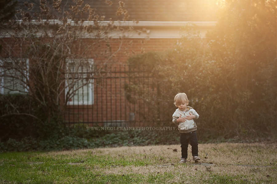 Little-Boy-Playing-in-a-Wash-of-Golden-Light-in-Yard-by-Nikki-Rainey