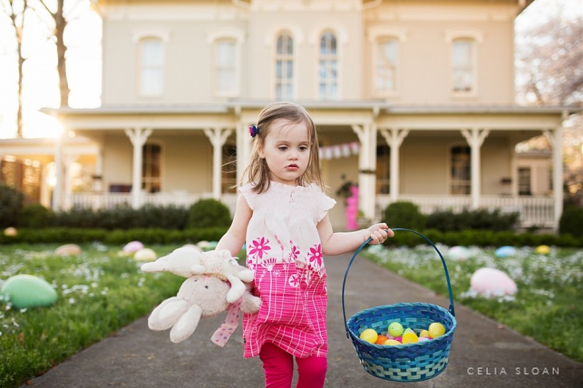 girl holding a bunny and her Easter basket by Celia Sloan