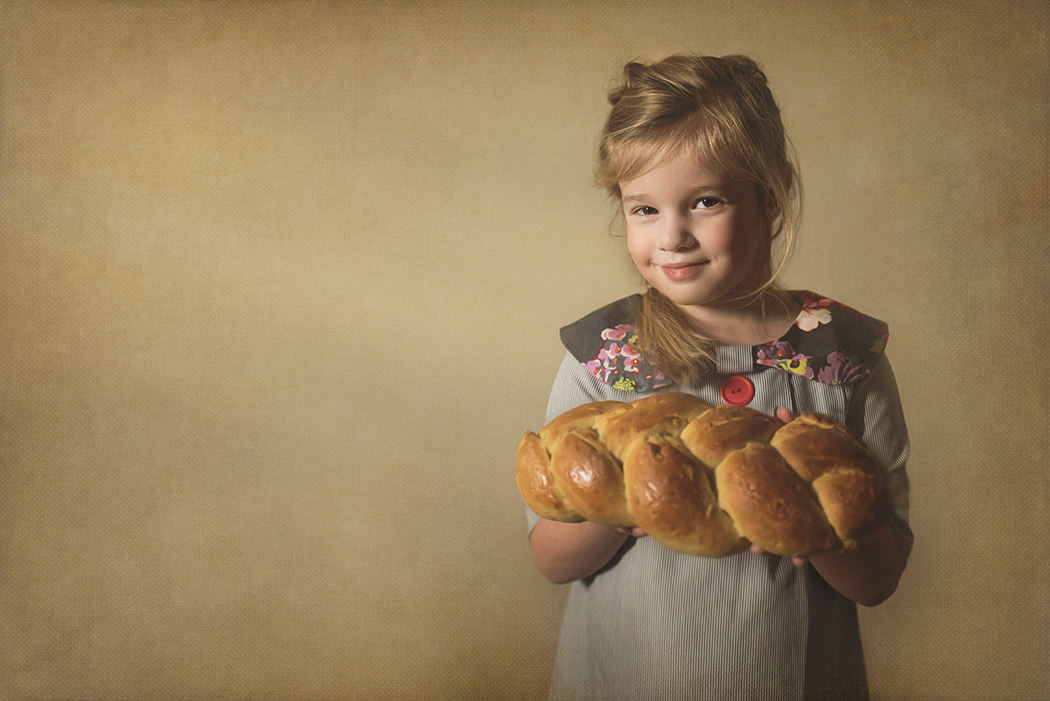 photo of girl holding homemade bread by Kellie Bieser