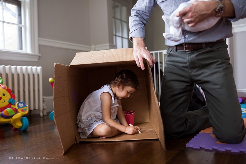 photo of kid drawing on a box by Beth Ann Fricker