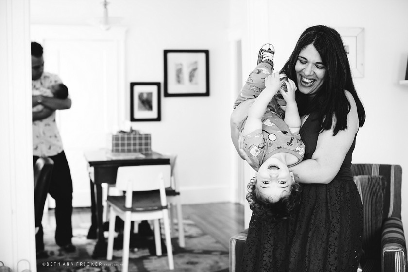 photo of mom holding child upside down by Beth Ann Fricker