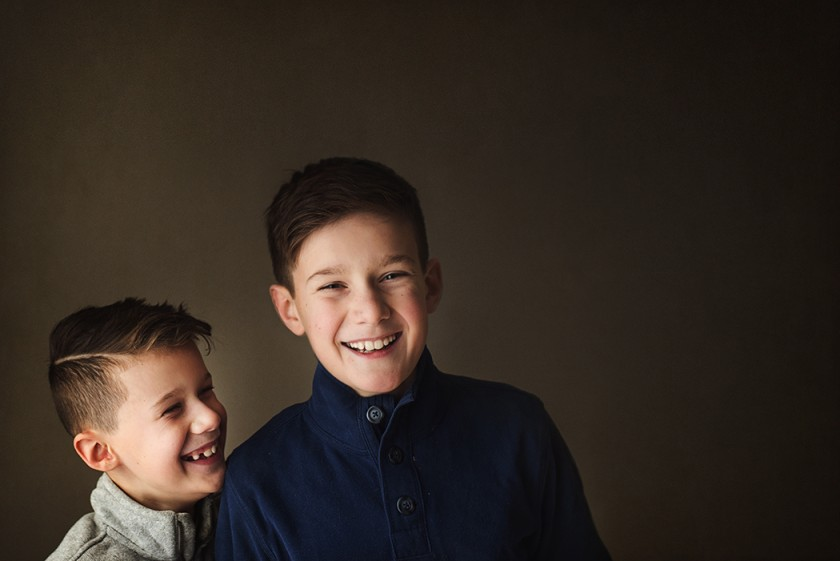 photo of two boys laughing together by Kellie Bieser