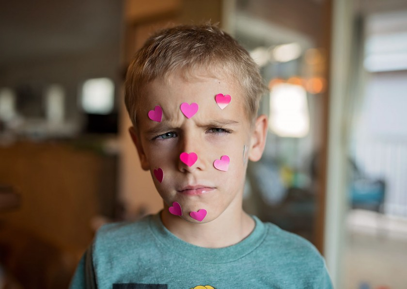 picture of boy with pink hearts on his face by Allison Gipson