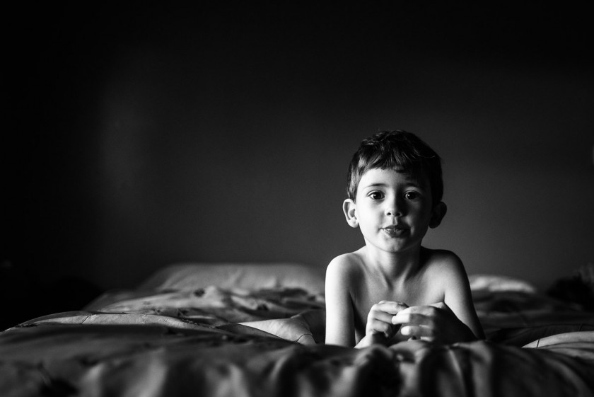 picture of child laying on the bed by Heather Mohr
