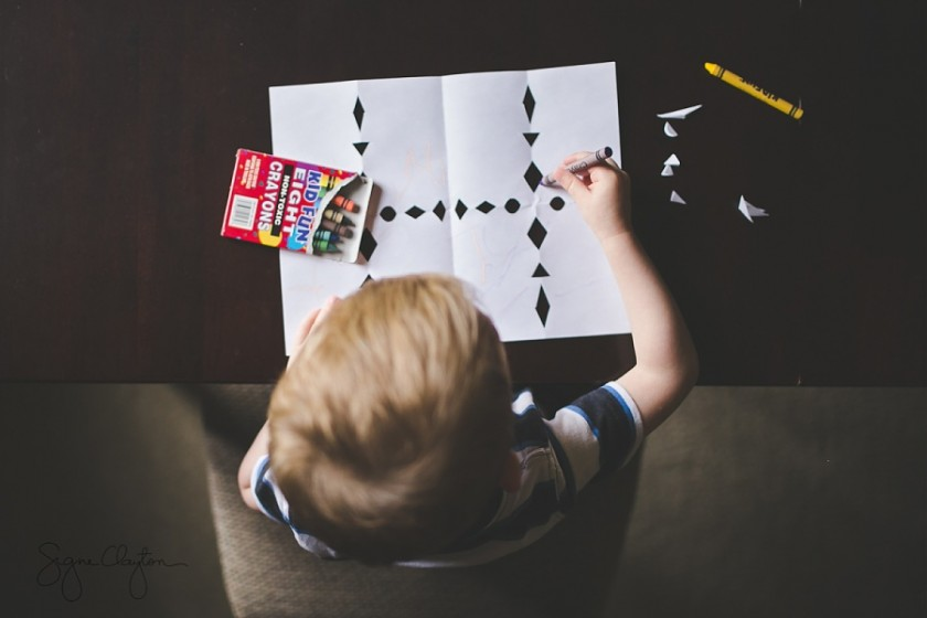 picture of kid doing a craft by Signe Clayton