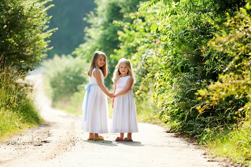 two girls wearing their Easter dresses by Lisa Rappa