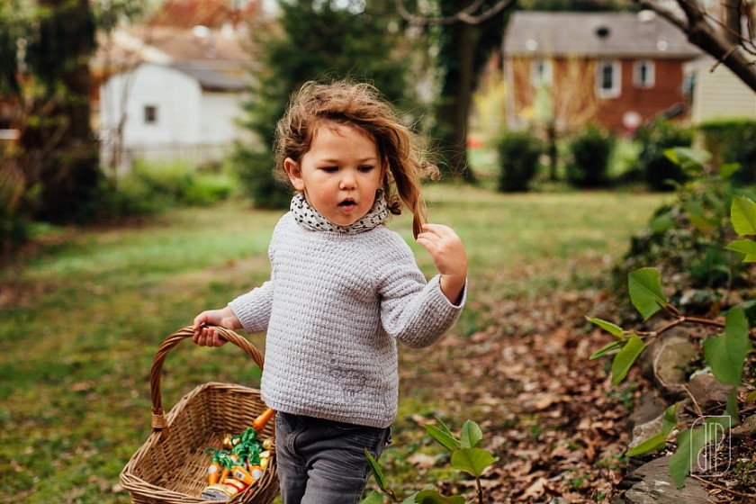 young girl hunting for Easter eggs by Juliette Fradin