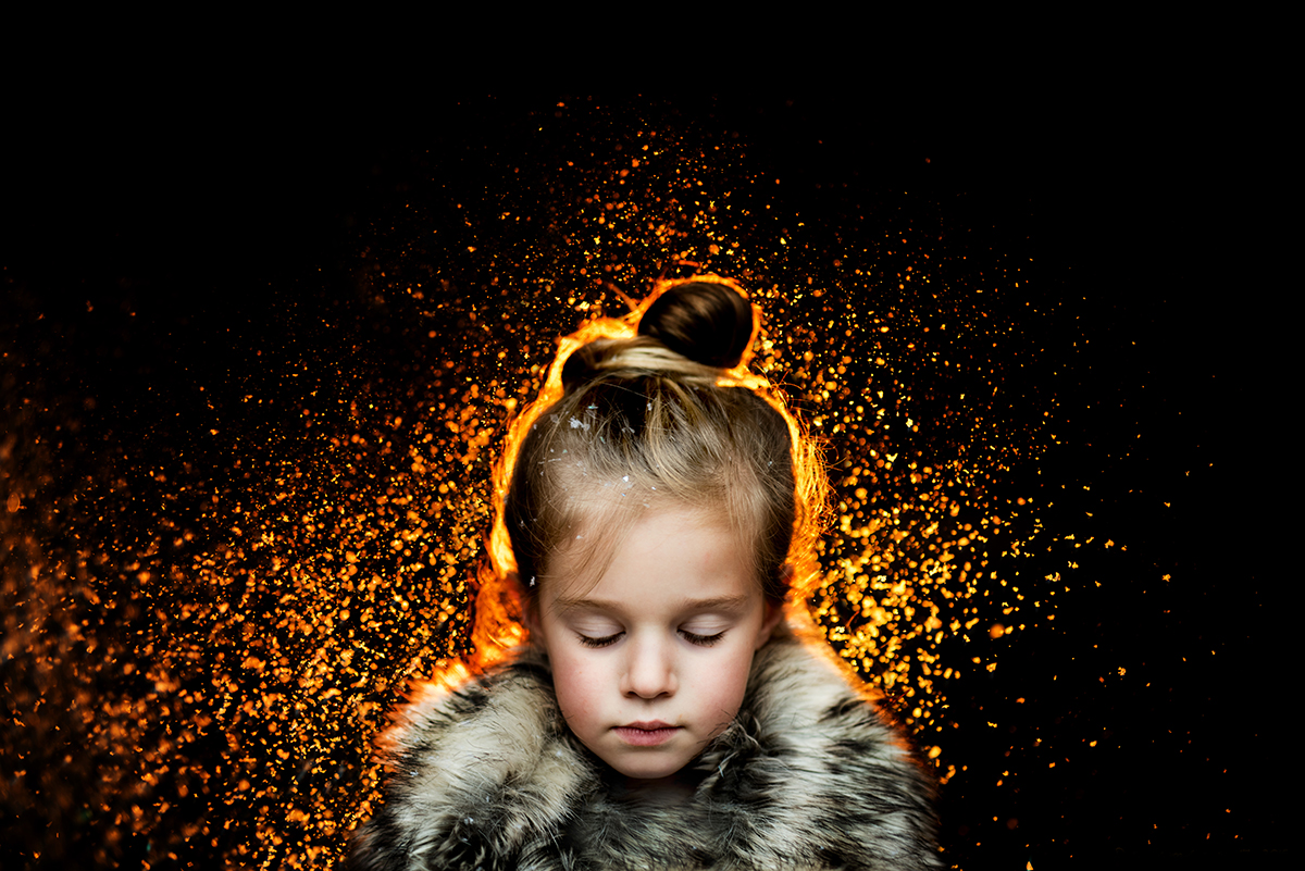 backlit flash picture of girl in a coat by Kellie Bieser