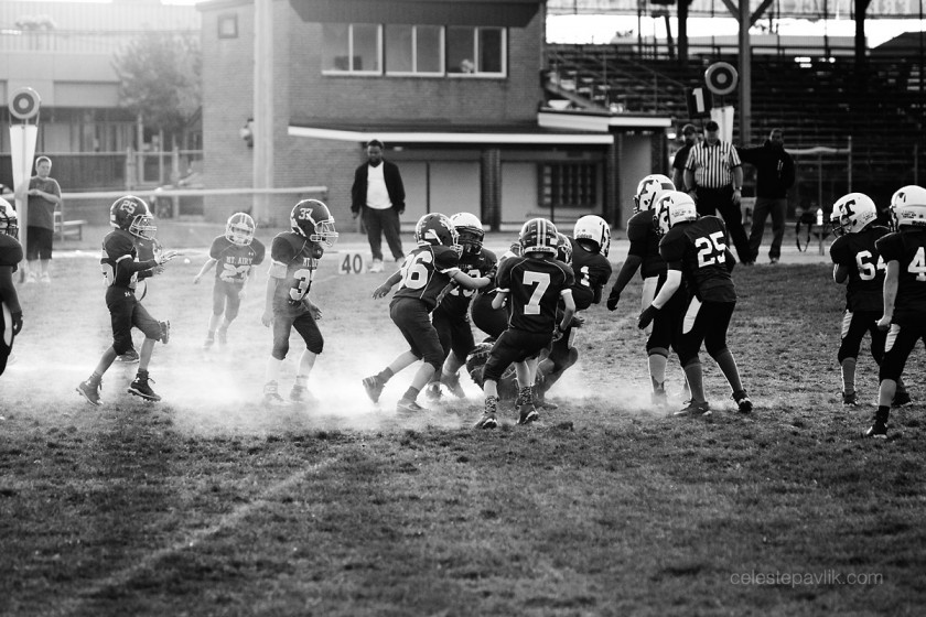 black and white photo of a football game by Celeste Pavlik