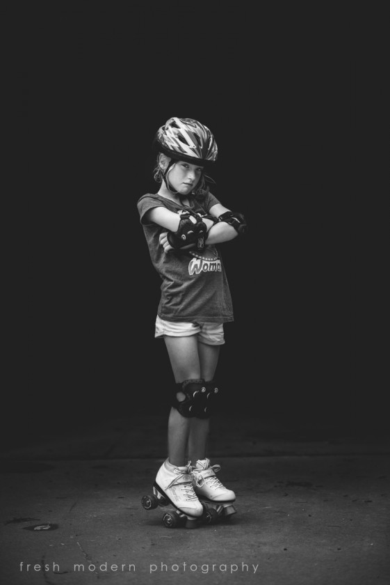 black and white photo of girl wearing roller skates by Mickie DeVries
