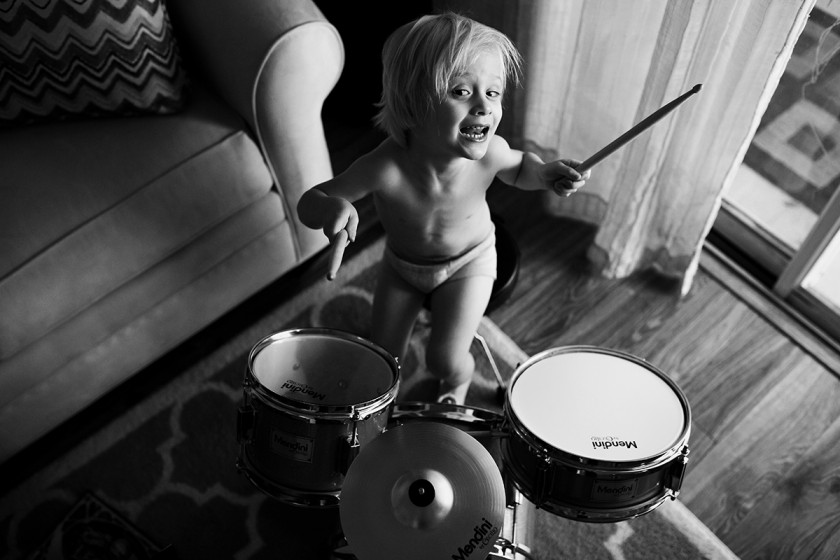 black and white picture of boy playing the drums by Jennifer Kielich