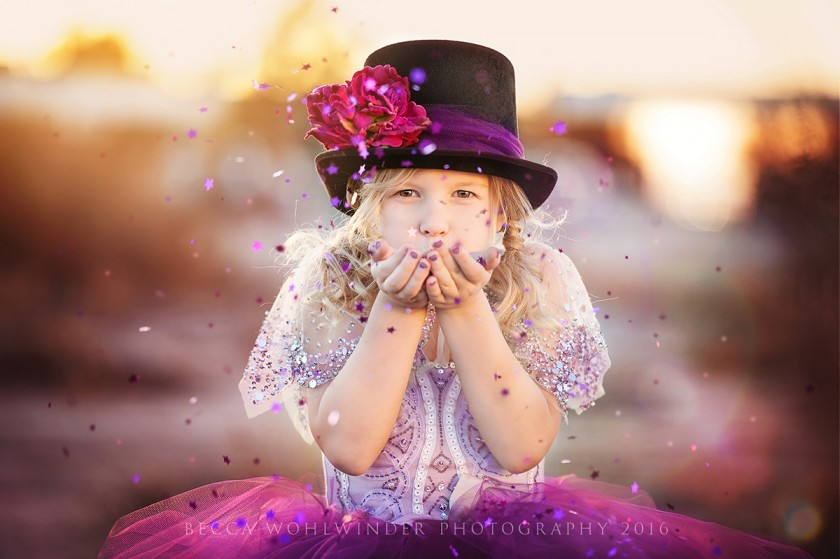colorful picture of girl blowing confetti stars out of her hand by Becca Wohlwinder