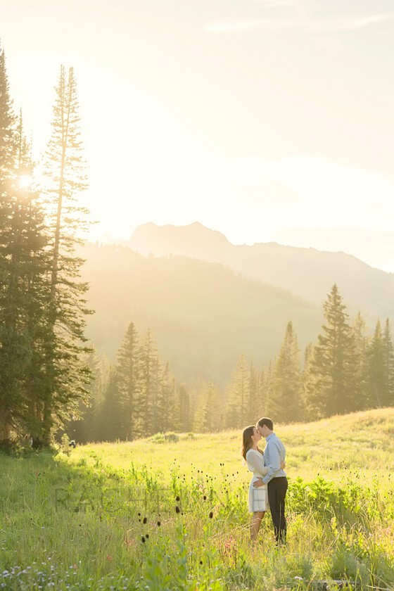 engagement kissing photo in a field by Rachel Nielsen