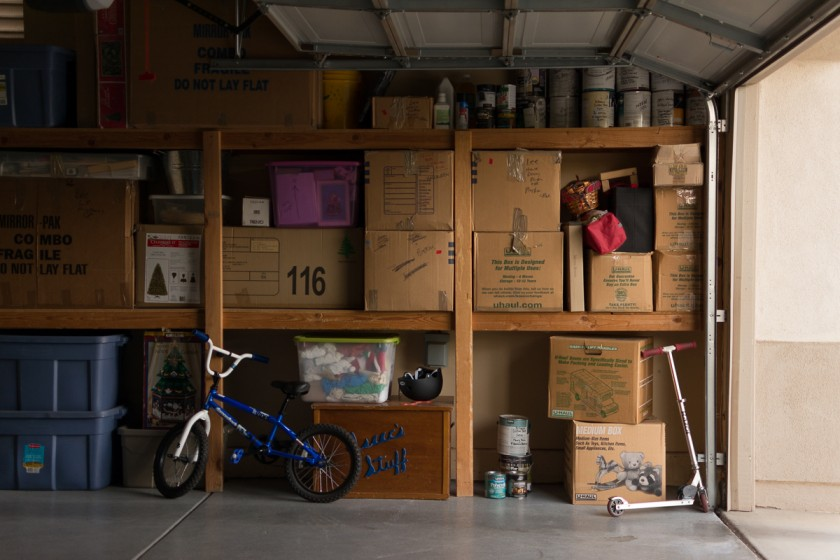 garage pullback full of shelves and boxes by Kerry Lee