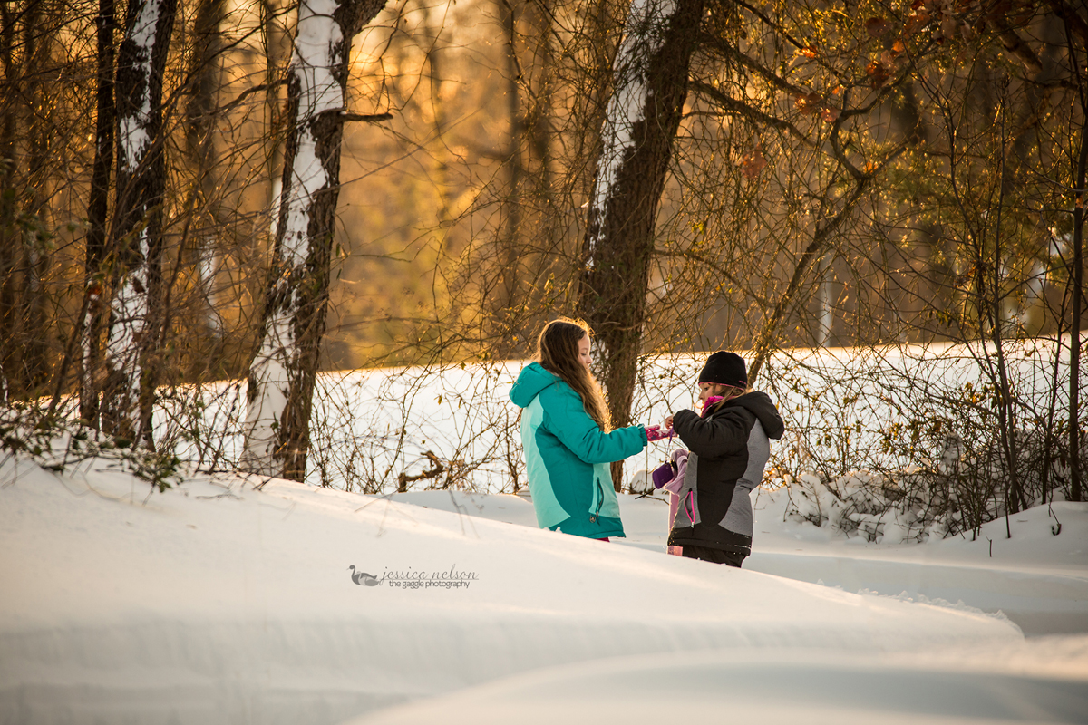 girls playing in the snow photo by Jessica Nelson