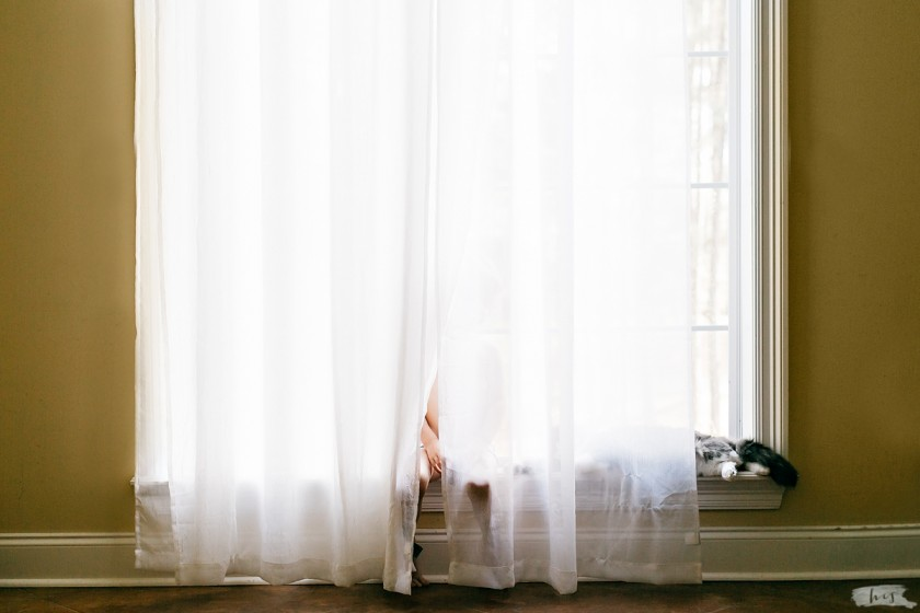 photo of boy and cat hiding behind a curtain by Heather Stockett