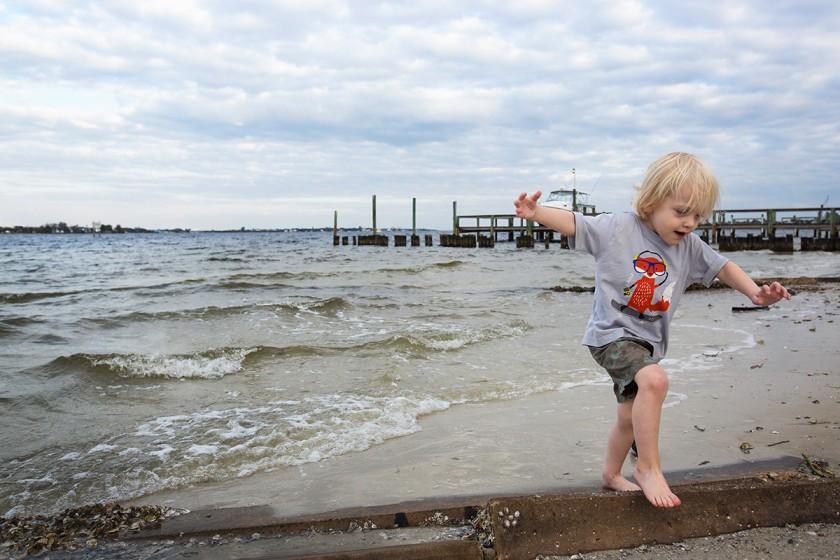 photo of boy playing on the beach by Jennifer Kielich