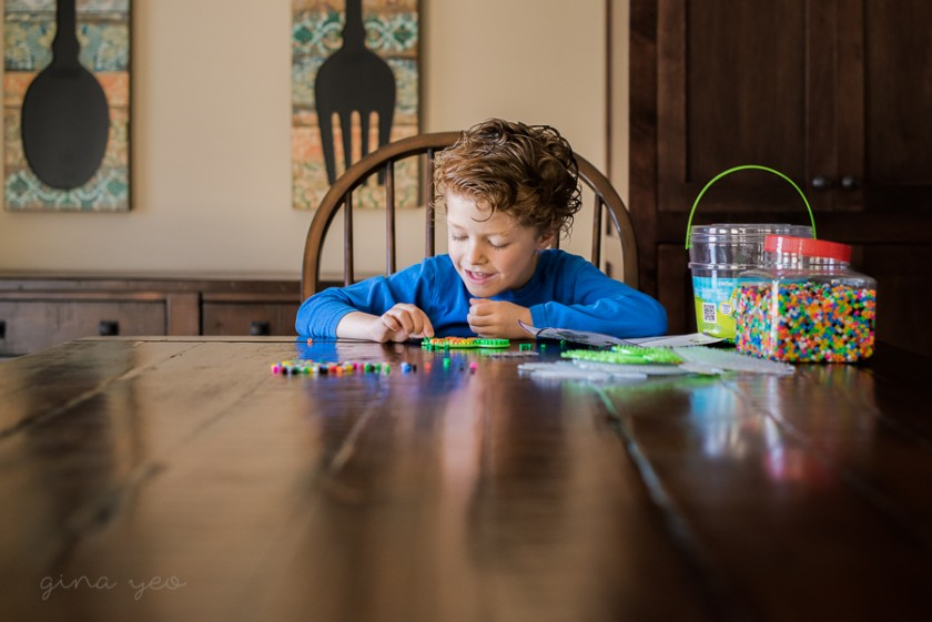 pic of boy playing at a table by Gina Yeo