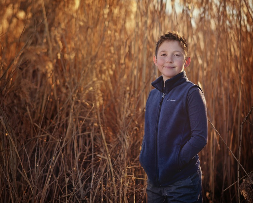 picture of boy in a field with reflected light by Michelle Turner