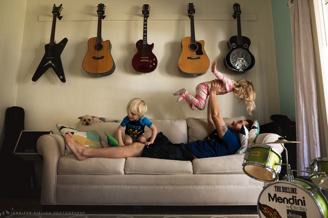 picture of dad on the couch with two kids by Jennifer Kielich