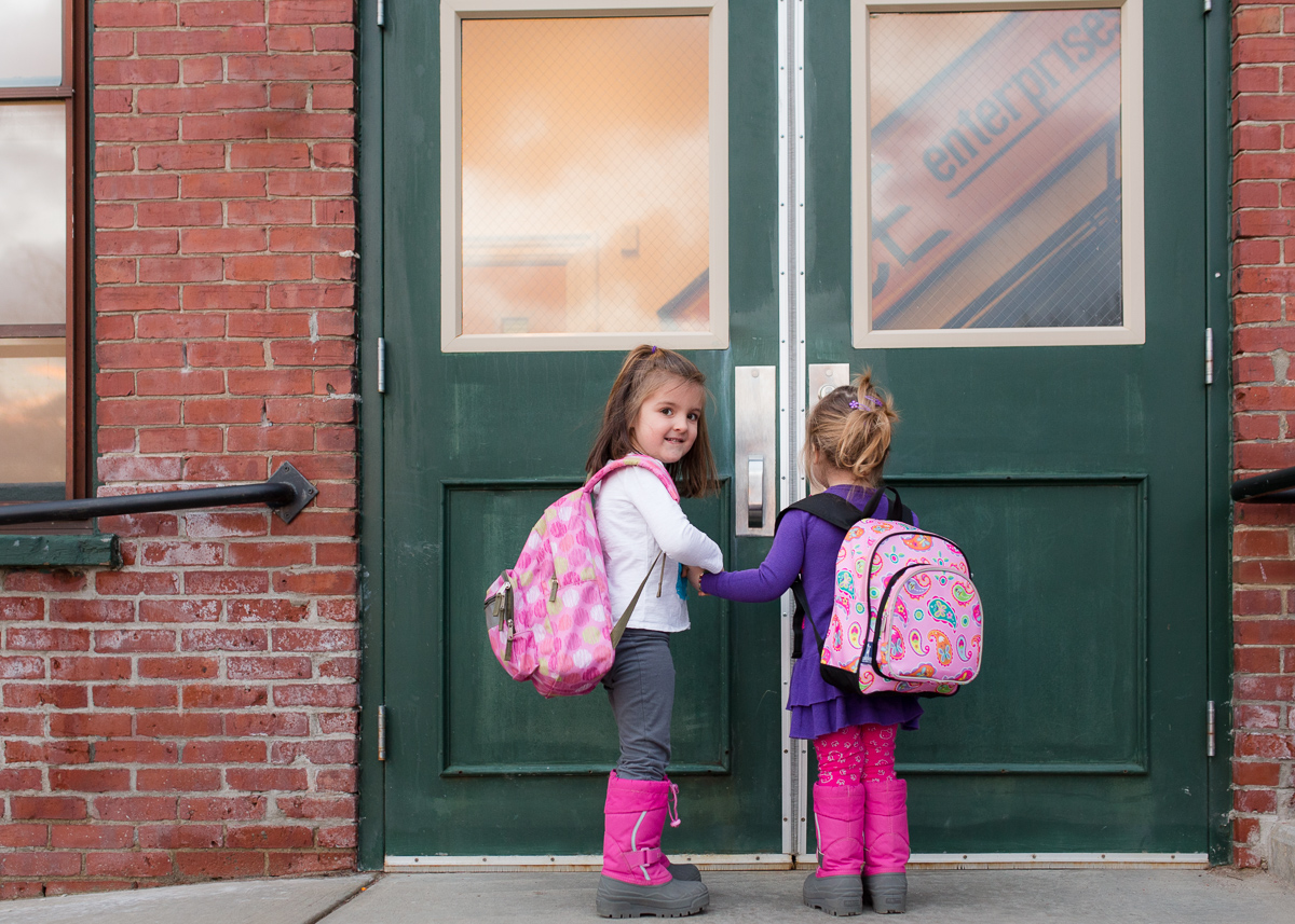 picture of two girls wearing backpacks by Kristy Dooley