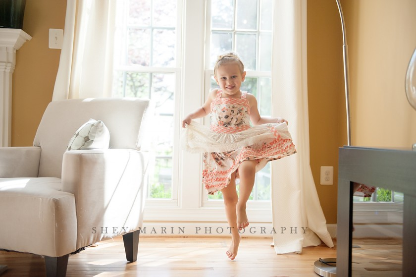 backlit picture of girl dancing and jumping by Shey Detterline