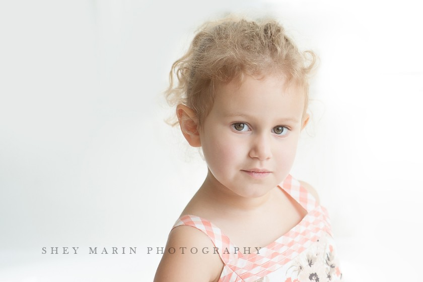 high key photo of curly haired girl by Shey Detterline
