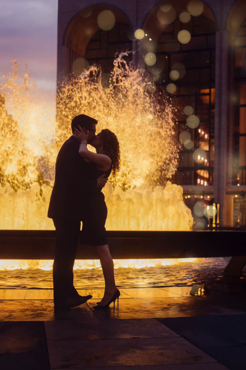 photo of a couple kissing by a water fountain by Melina Nastazia