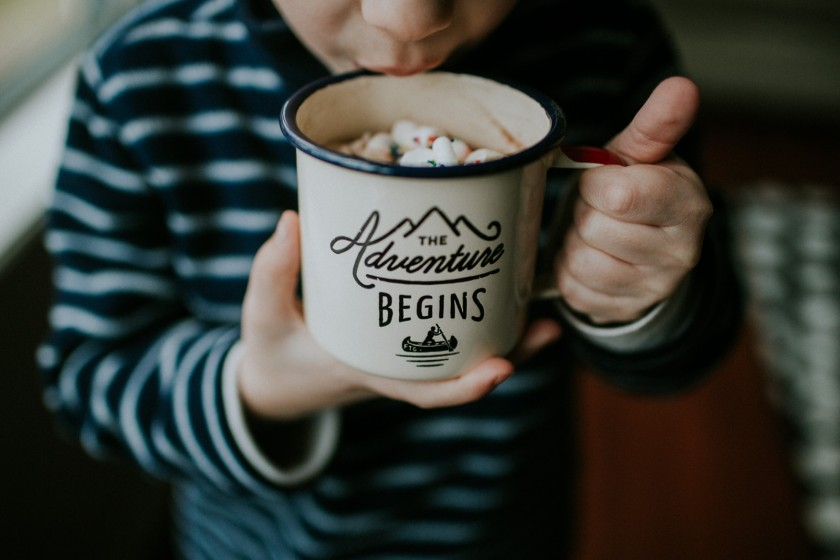 photo of boy drinking hot chocolate with marshmallows by Cassandra McCasley of Twist and Shutter Photography