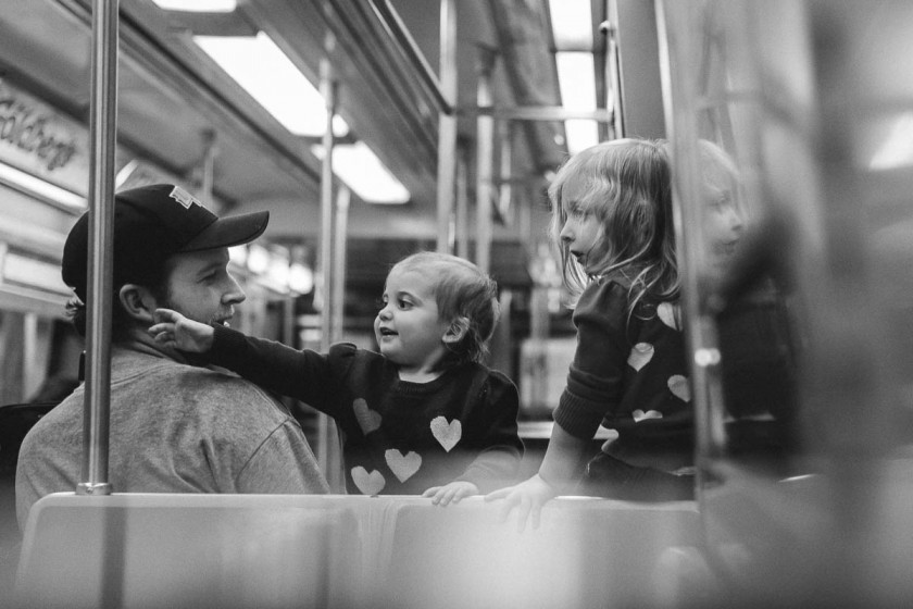 pic of dad and two kids on the subway by Melina Nastazia