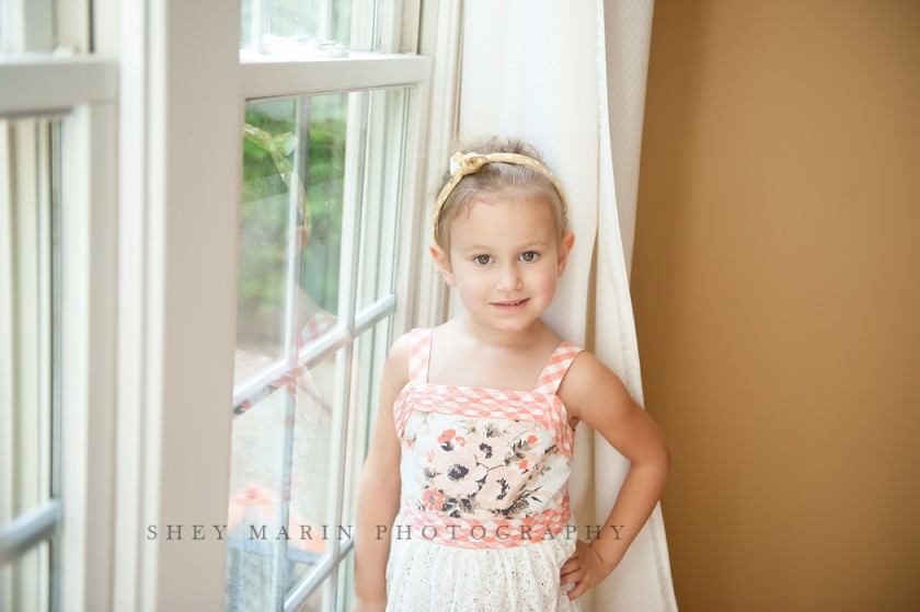 picture of girl standing by a window by Shey Detterline