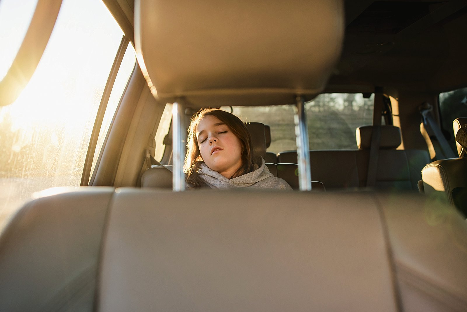 picture of young girl sleeping in the car by Brittany Blake