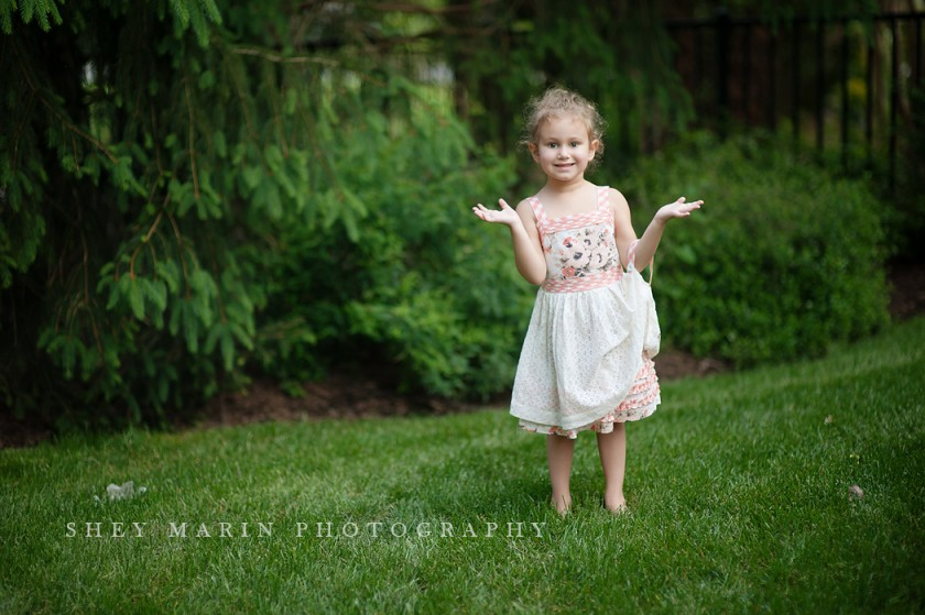 pullback of photos in a grassy backyard by Shey Detterline