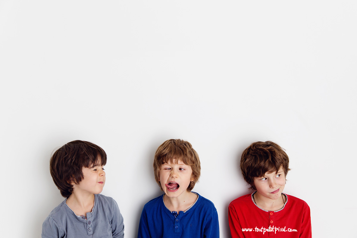 3 boys making silly faces by Lisa Tichane
