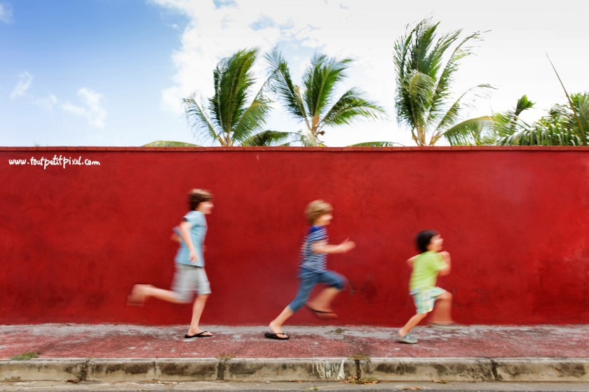 boys running by a red wall by Lisa Tichane 3