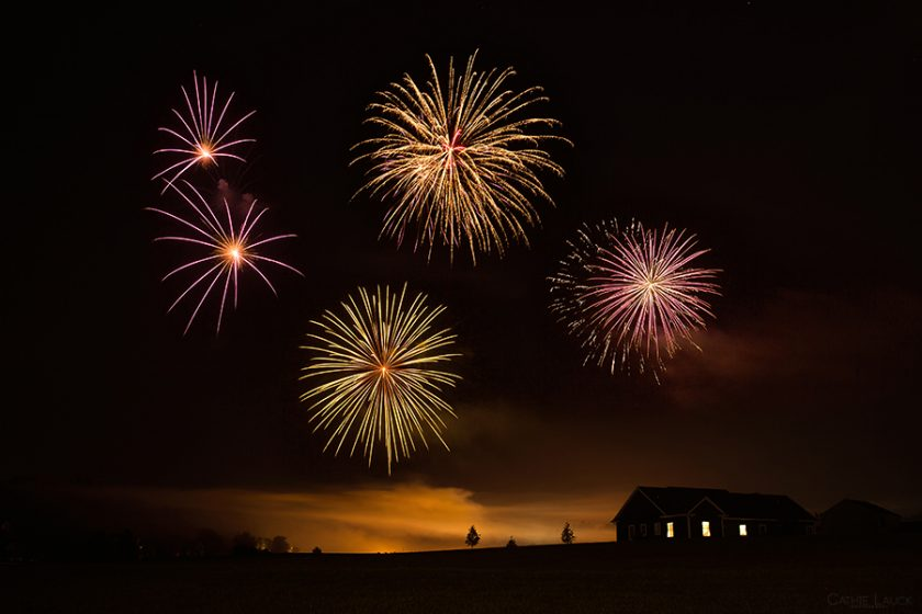 fireworks show by a house in the country by Cathie Lauck