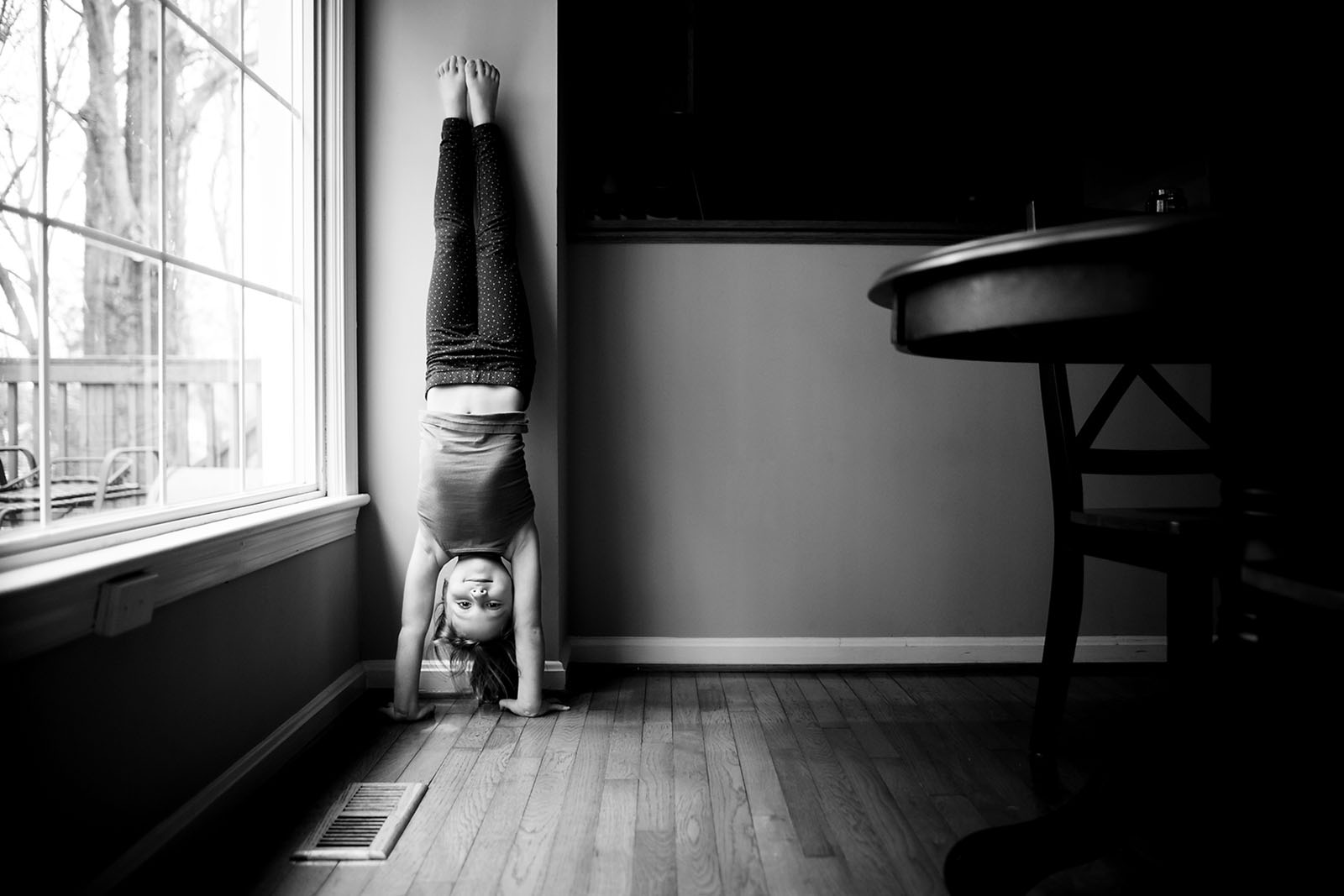 girl doing a handstand by Allison McSorley