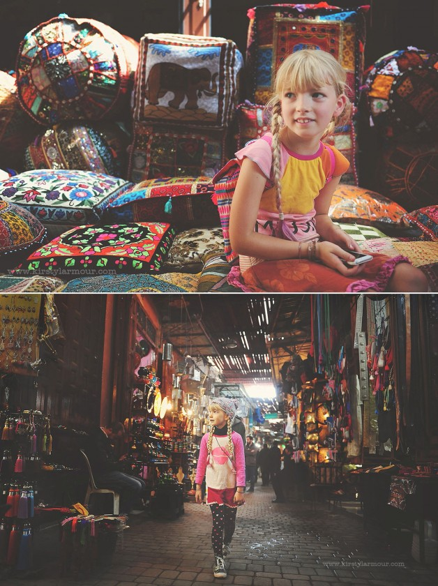 girl shopping in a colorful market by Kirsty Larmour 11