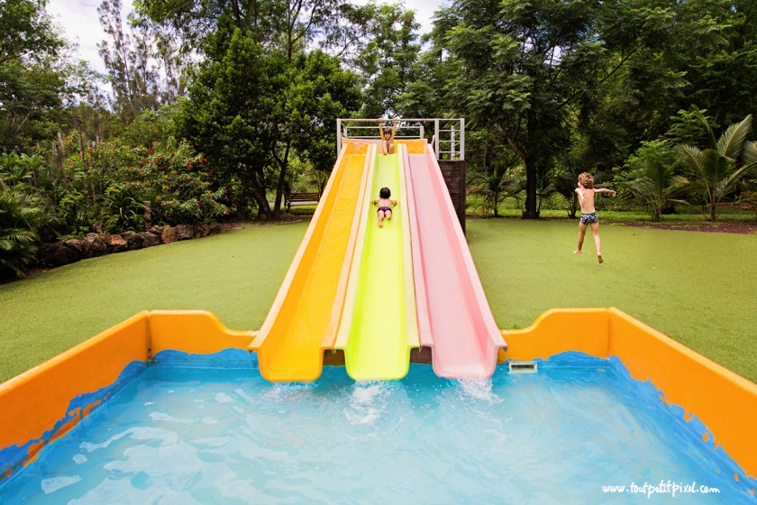 photo of kids sliding down a water slide by Lisa Tichane