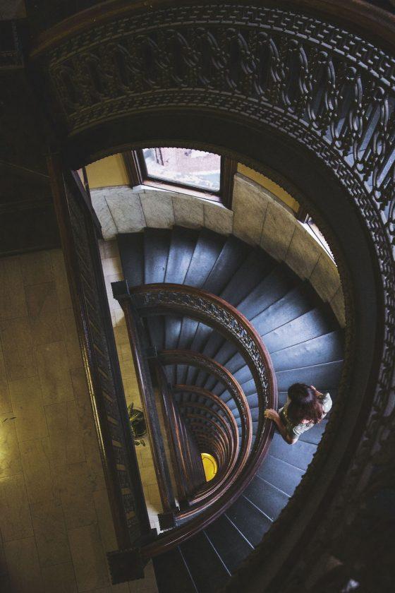 photo of woman walking down a staircase by Jen Kashak